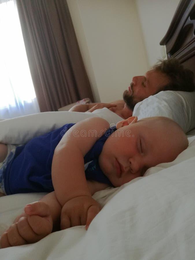 Dad and son sleep stock photos