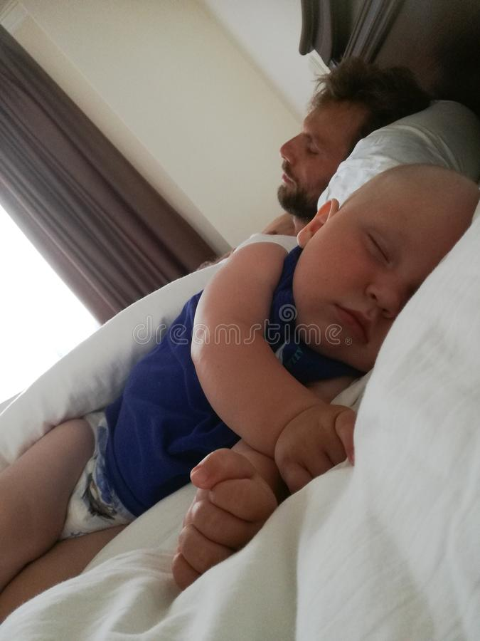 Dad and son sleep stock photo