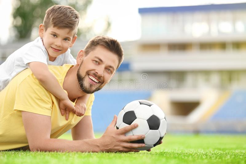 Dad and son with soccer ball. royalty free stock photography