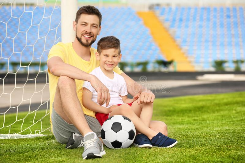 Dad and son with soccer ball stock image