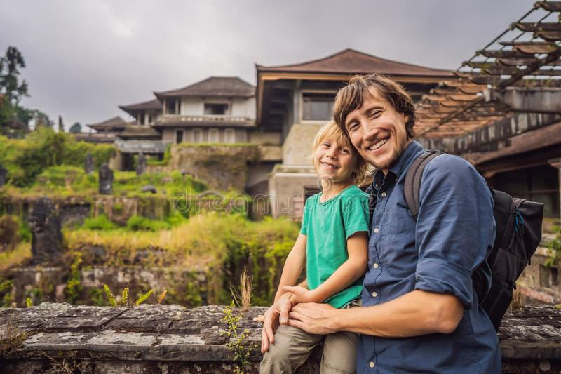 Dad and son tourists in abandoned and mysterious hotel in Bedugul. Indonesia, Bali Island. Bali Travel Concept.  stock image
