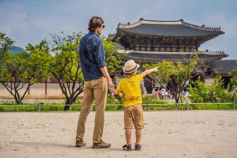 Dad and son tourists in Korea. Gyeongbokgung Palace grounds in Seoul, South Korea. Travel to Korea concept. Traveling stock photo
