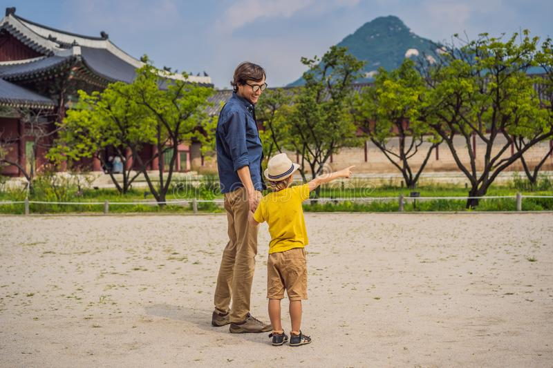 Dad and son tourists in Korea. Gyeongbokgung Palace grounds in Seoul, South Korea. Travel to Korea concept. Traveling stock photography