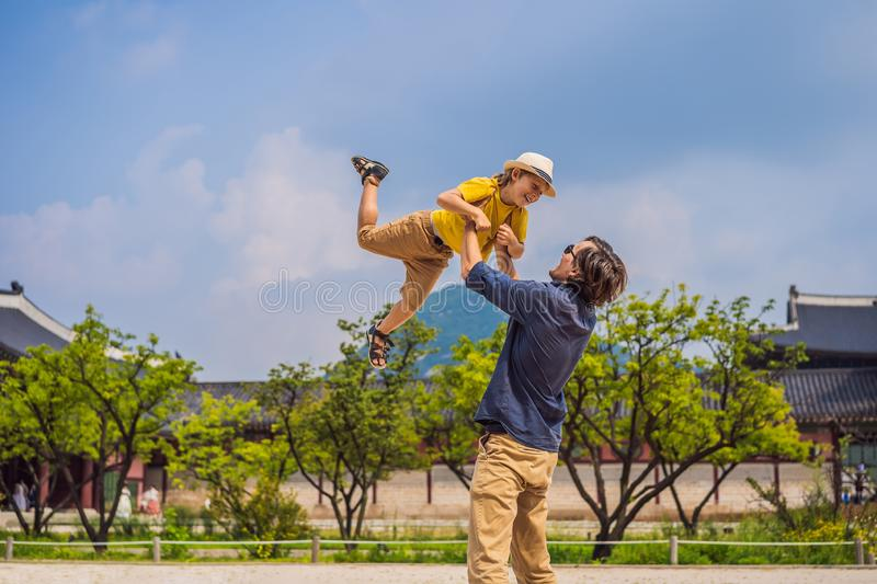 Dad and son tourists in Korea. Gyeongbokgung Palace grounds in Seoul, South Korea. Travel to Korea concept. Traveling stock photos