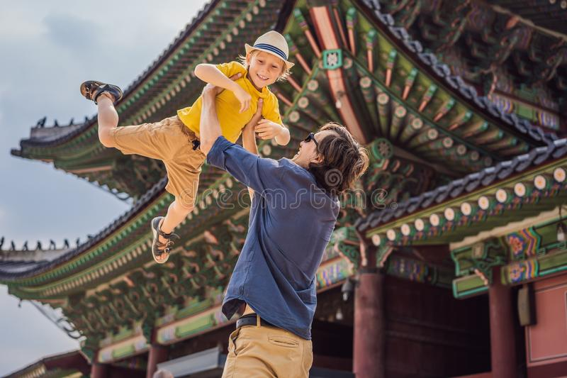 Dad and son tourists in Korea. Gyeongbokgung Palace grounds in Seoul, South Korea. Travel to Korea concept. Traveling royalty free stock images