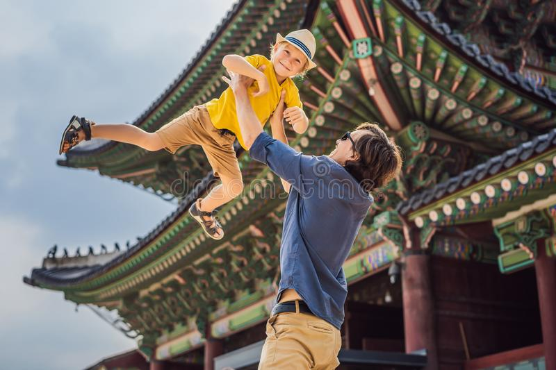 Dad and son tourists in Korea. Gyeongbokgung Palace grounds in Seoul, South Korea. Travel to Korea concept. Traveling royalty free stock photos