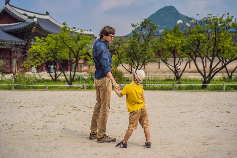 Dad and son tourists in Korea. Gyeongbokgung Palace grounds in Seoul, South Korea. Travel to Korea concept. Traveling royalty free stock photography