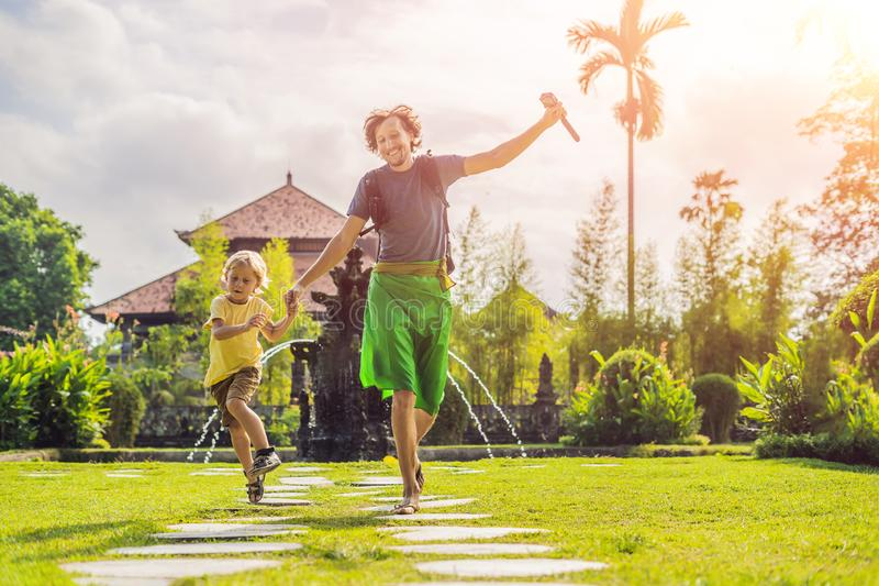 Dad and son tourists in Traditional balinese hindu Temple Taman Ayun in Mengwi. Bali, Indonesia. Traveling with children concept w. Dad and son tourists in royalty free stock image