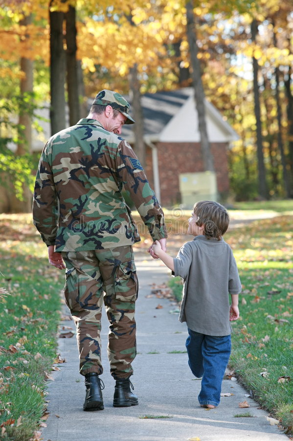 Dad and Son Walking. Military Dad and Son Holding Hands Walking stock image