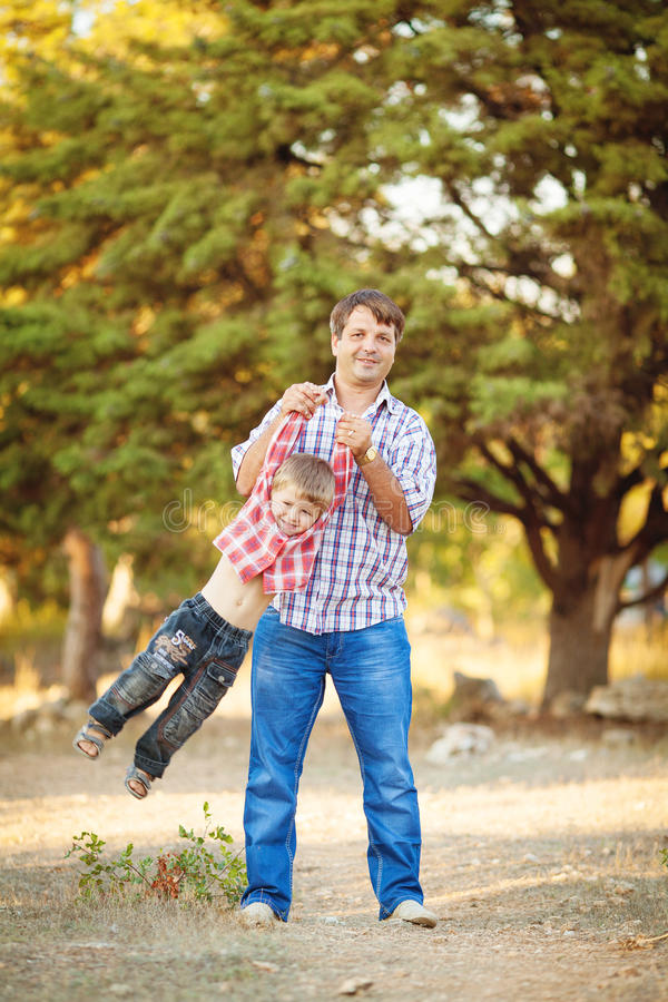Download Dad And Son Walking In The Park In Summer Stock Image - Image: 36710943
