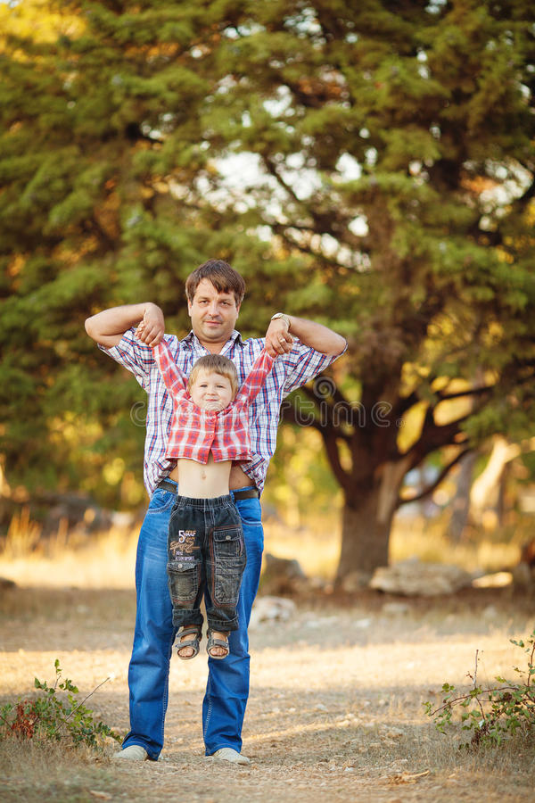 Download Dad And Son Walking In The Park In Summer Stock Image - Image: 36710945