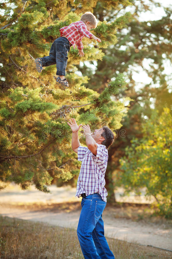 Download Dad And Son Walking In The Park In Summer Stock Image - Image of male, outdoor: 36710961