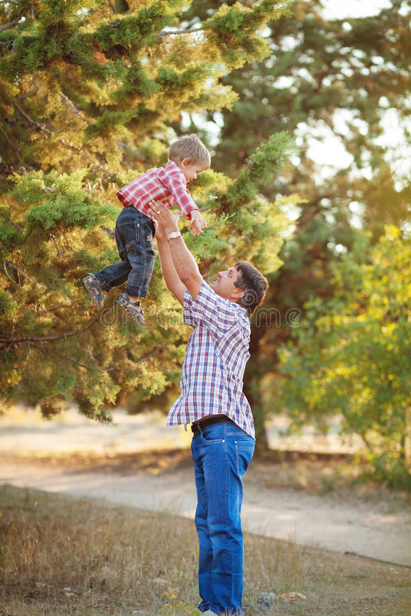 Download Dad And Son Walking In The Park In Summer Stock Photo - Image: 36710962