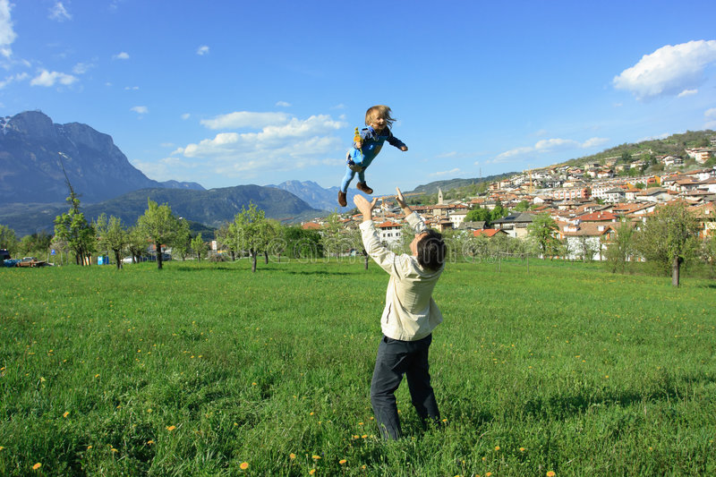 Download Dad Throwing Daughter In Air Stock Image - Image of family, countryside: 5582531