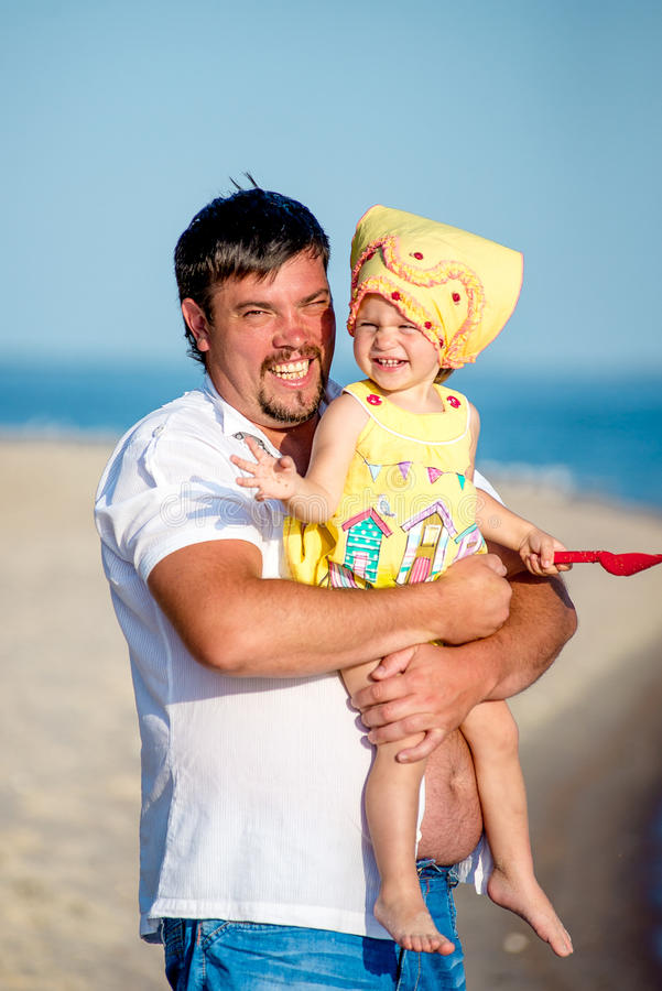 Dad walks with his daughter stock image