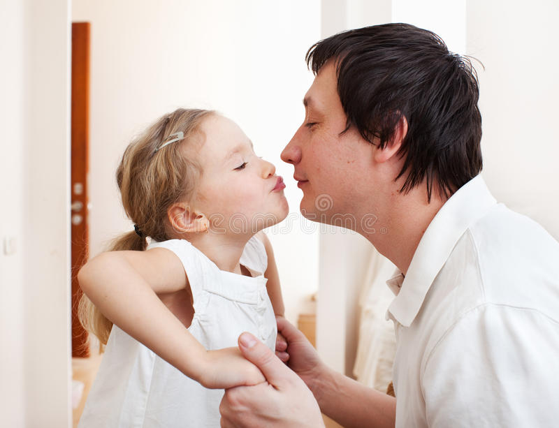 Dad wth daughter. Daughter kissing her dad. Happy family royalty free stock photography