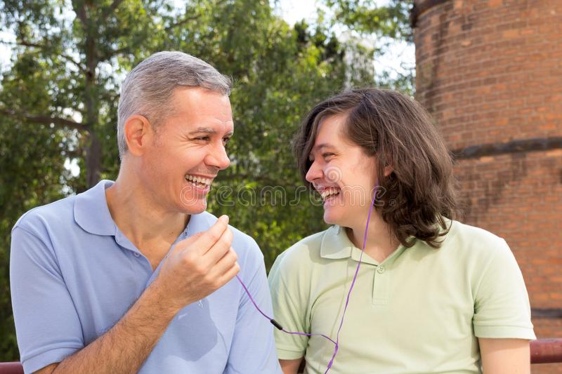 Dad and young adult son. Fathers Day. Parent is sharing interest stock photo