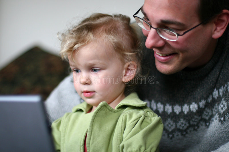 Daddy and Baby at Computer stock photos