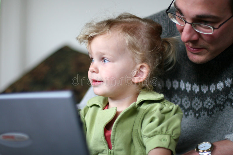 Daddy and Baby at Computer stock photography