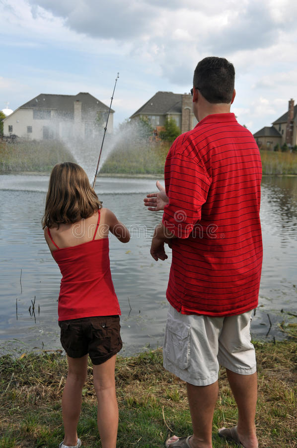Daddy daughter fishing 3 royalty free stock photo