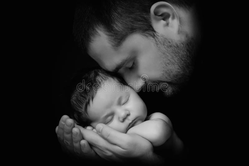 Download daddy hugs his newborn baby father s love close up portrait