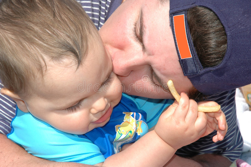 Daddy Kisses royalty free stock photos