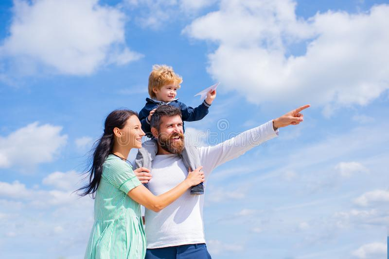 Daddy, mommy and child son. Happy family - child son playing with paper airplane. Portrait of happy father giving son royalty free stock images