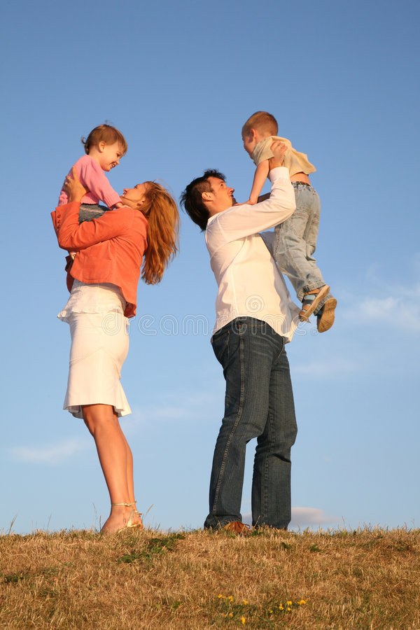 Download Daddy And Mommy Hold Children Stock Image - Image: 3358373
