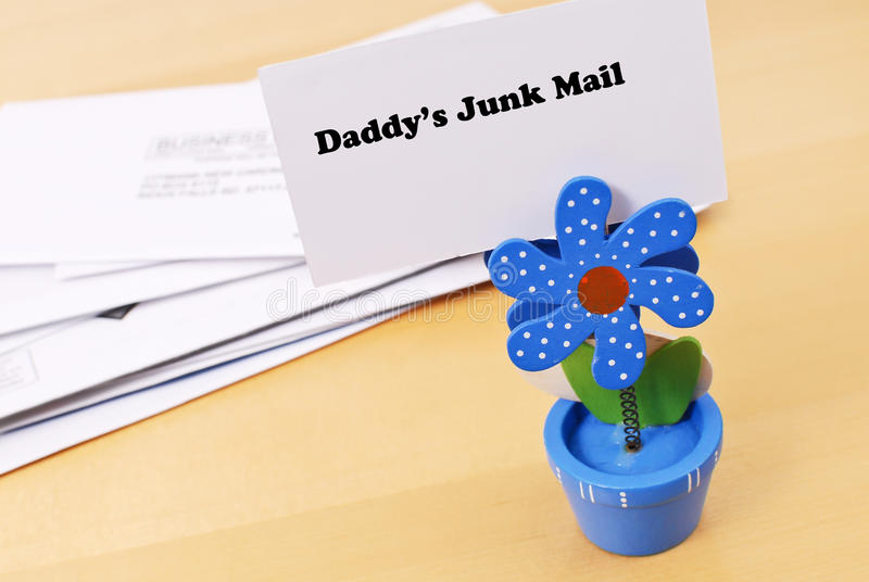 Daddys Junk Mail Pile. Flower Mail Holder, Holding Up Sign For Daddy's Junk Male Pile stock photography