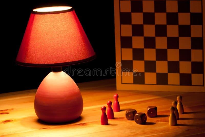 Dadi illuminating della lampada fotografie stock