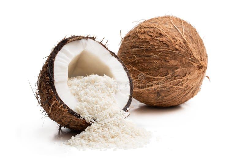 Dado con i fiocchi della noce di cocco isolati su bianco fotografie stock libere da diritti