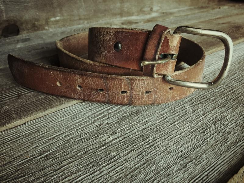 Dads Belt. My Dad passed away over half of my life ago, I have a few of his things left and I thought it would vena good idea to photograph them royalty free stock photo