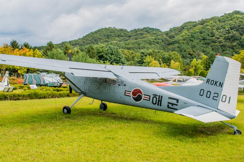 Left rear view of Cessna 140. Daejeon, South Korea; October 3, 2019: Left rear view of Cessna 140 military flight trainer on display at National Cemetery royalty free stock photography