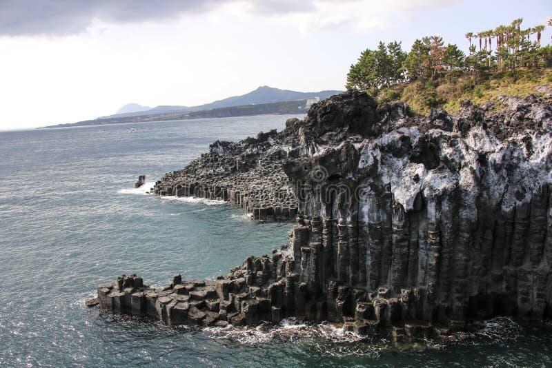 The Daepo Jusangjeolli Jusangjeollidae basalt columnar joints and cliffs on Jeju Island, South Korea stock photography
