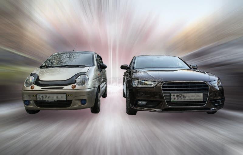 Daewoo Matiz and Audi A4. stock images