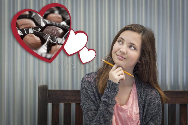 Dagdromenmeisje naast Drijvende Harten met Chocolade royalty-vrije stock afbeelding