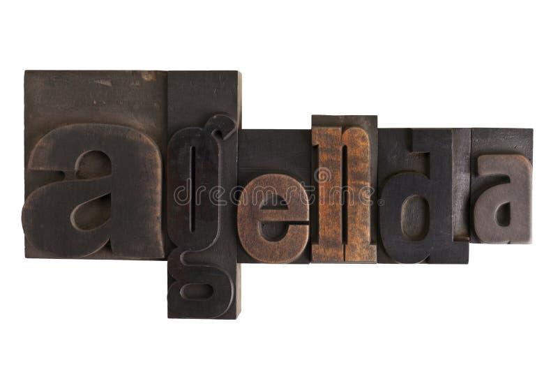 Dagordning ord som är skriftligt i boktrycktypkvarter arkivfoton