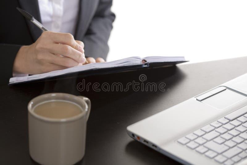 dagordningaffärskvinna henne writing fotografering för bildbyråer