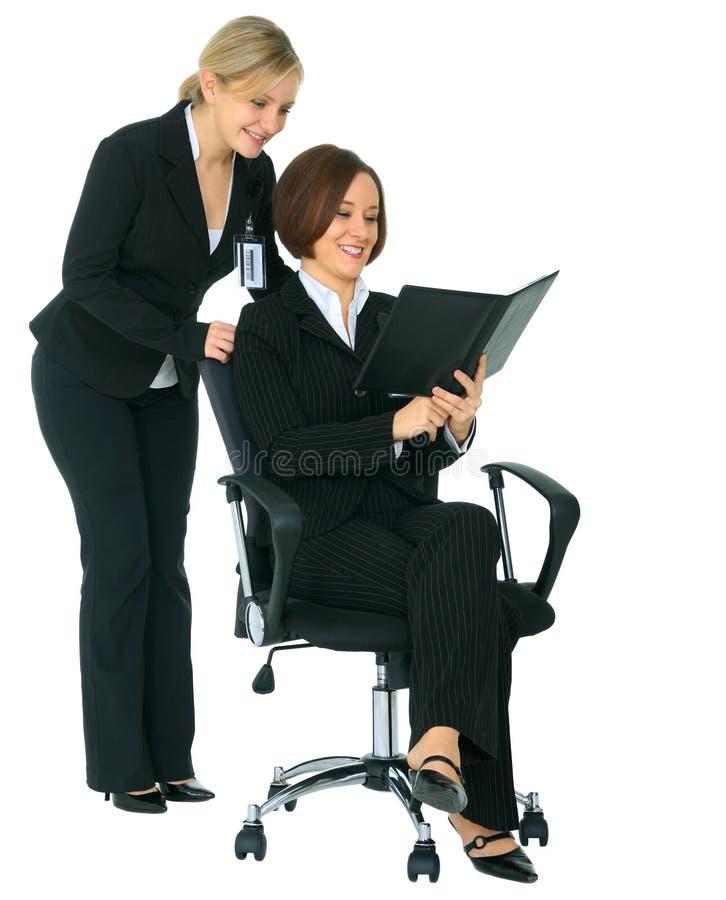 dagordningbusinessteam som ser kvinnor royaltyfria bilder