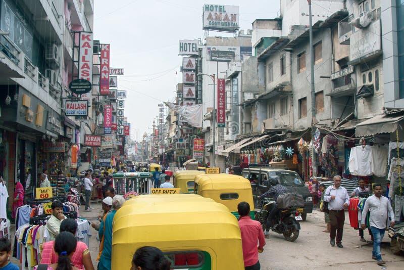 dagströmtrick åker taxi och köpare Hindus royaltyfria foton
