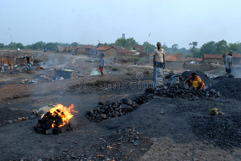 Dailylife Of Jharia. They collect the coal, and burn it once in order to improve its quality, breathing in the poisonous smoke containing carbon monoxide royalty free stock photography