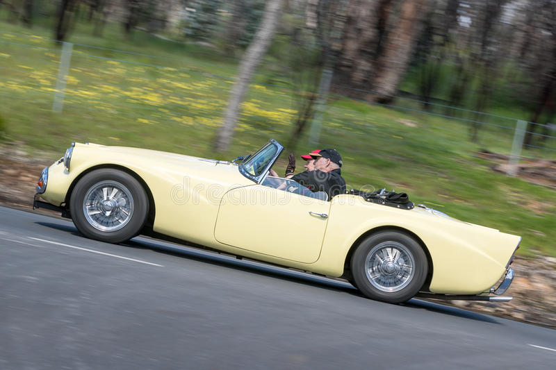 1959 Daimler SP 250 Roadster. Adelaide, Australia - September 25, 2016: Vintage 1959 Daimler SP 250 Roadster driving on country roads near the town of Birdwood royalty free stock photography