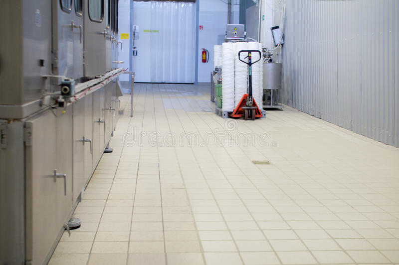 Dairy factory workshop. With tiles on a floor stock photography