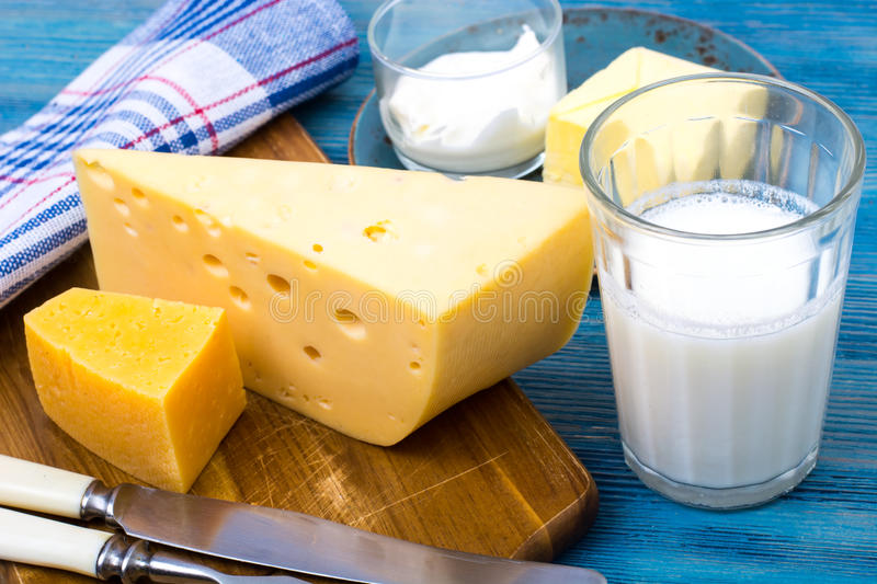 Dairy products as background of healthy food on blue royalty free stock photo