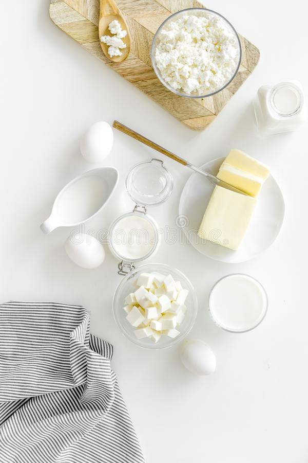 Eggs, butter, milk, yougurt, cottage for natural farm products yougurt on white background top view monochrome pattern royalty free stock photo