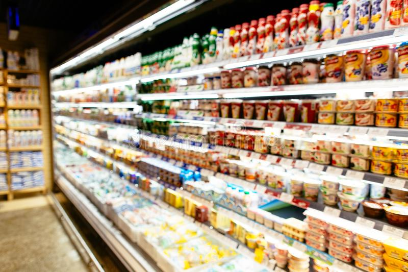 Dairy products in refrigerator of supermarket. stock photo