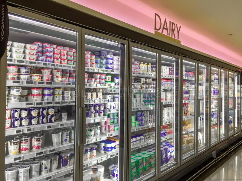 Dairy. Products in supermarket chiller fridge stock image