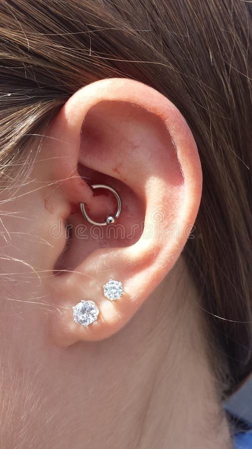 Daith Piercing. To get rid of migraines stock images