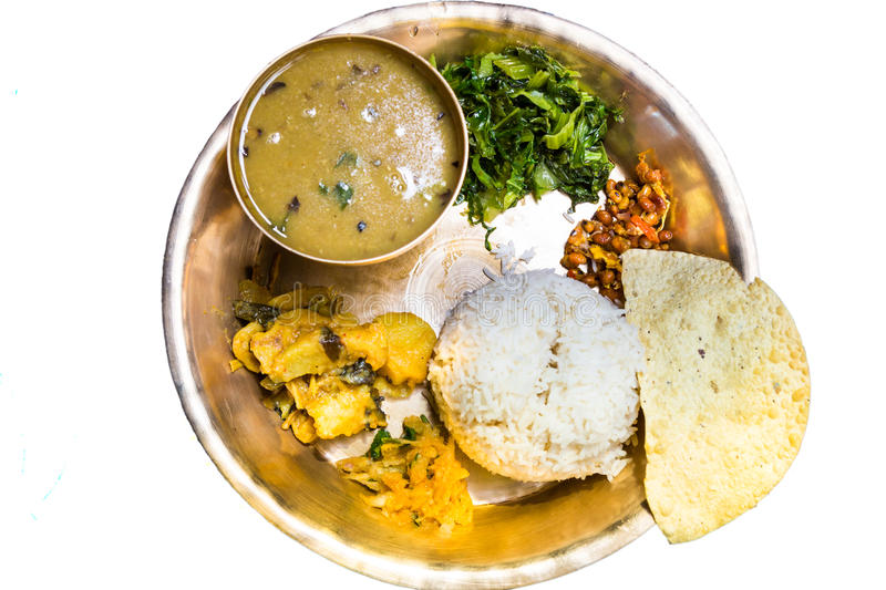 Dal Bhat, traditional Nepali meal platter with rice, lentils soup, vegetables, papadum and spices royalty free stock photography