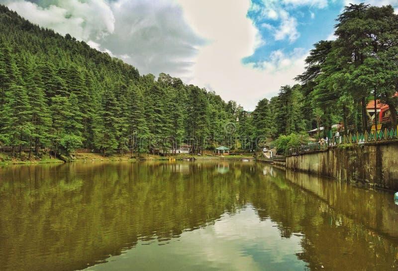 Dal Lake, Dharamshala, Himachal Pradesh. Dal Lak in Dharamshala, Himachal Pradesh near Mcleodganj during monsoons formed between the pinewood treed planted over stock photography